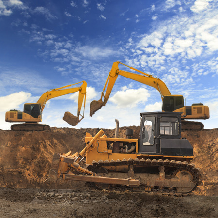 grader: Excavator and grader working at construction site Stock Photo