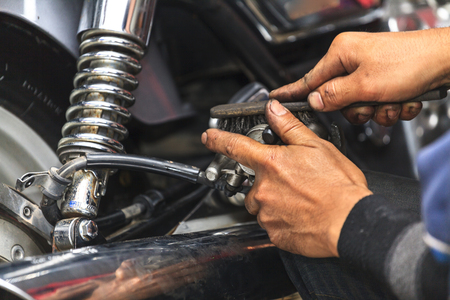 garage background: Cropped view of Motorcycle mechanic,Technician