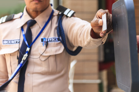 barrier gate: Security guard with opening barrier gate Stock Photo