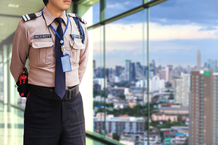 security uniform: Security guard on modern office building