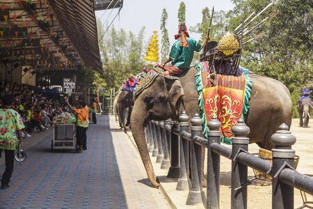 show garden: NAKHON PATHOM - MARCH 17: Unidentified Thai and International people enjoy The famous elephant show at The Rose Garden Nakhon Pathom Province on March 17, 2016 in Nakhon Pathom, Thailand