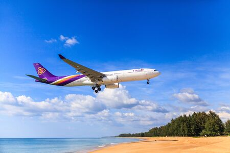 december 25: PHUKET, THAILAND - December 2015 : Thai airways airplane Landing at Phuket International airport in sunny day on December 25, 2015 in Phuket, Thailand.