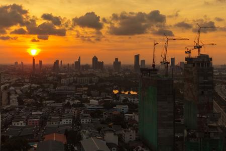 orange sunset: Construction sites in Bangkok, Thailand at sunrise