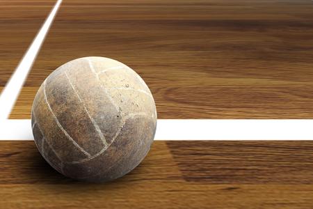 Volleyball ball on hardwood volleyball court Stock Photo