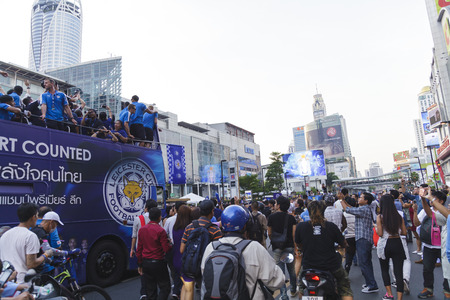 premier: BANGKOK THAILAND-MAY 19, 2016 : Leicester City parades Premier League trophy as brings thousands of fans turn out to open-top bus celebration in Bangkok, Thailand.