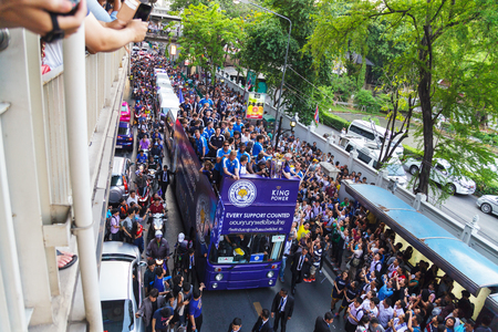 leicester: BANGKOK THAILAND-MAY 19, 2016 : Leicester City parades Premier League trophy as brings thousands of fans turn out to open-top bus celebration in Bangkok, Thailand.