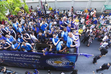 premier league: BANGKOK THAILAND-MAY 19, 2016 : Leicester City parades Premier League trophy as brings thousands of fans turn out to open-top bus celebration in Bangkok, Thailand.