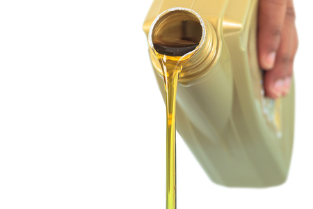 Motor oil pouring on white background
