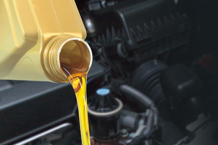 lubricant: Motor oil pouring, Pouring oil lubricant motor car from bottle