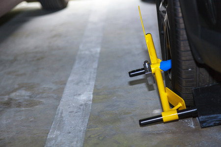 clamped: Clamp vehicle, wheel lock, Car was locked with clamped vehicle