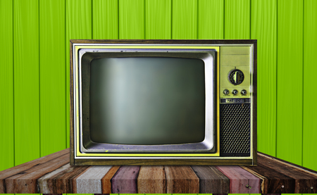 vintage television: Vintage television on wooden table background Stock Photo