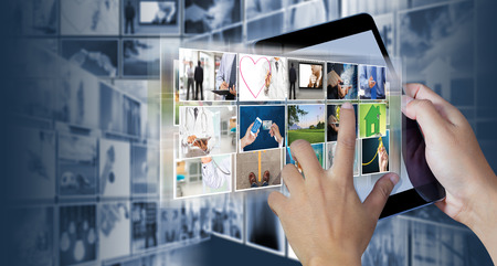 communications tools: Hand holding the digital tablet with Picture gallery Stock Photo