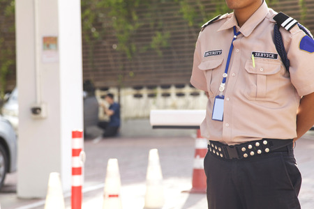 barrier: Security guard with opening barrier gate Stock Photo