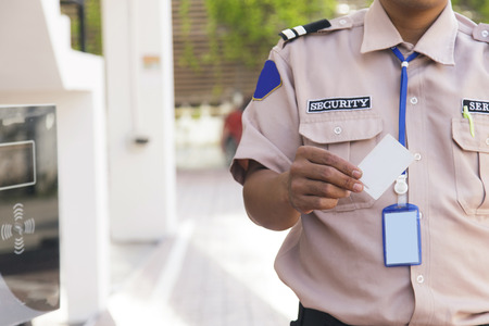 security barrier: Security guard with opening barrier gate Stock Photo