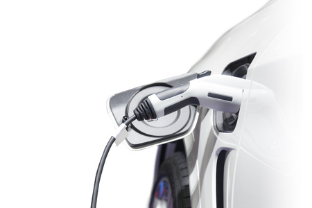 Charging an electric car, Future of transportation Stockfoto