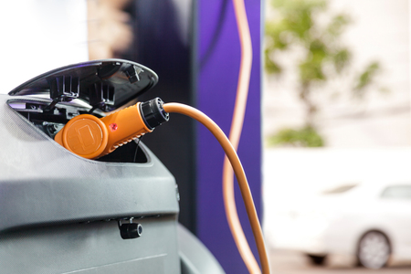 Charging an electric car, Future of transportation Stock Photo