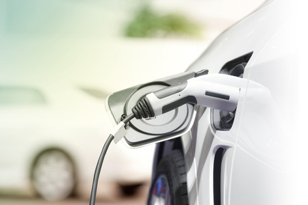 Charging an electric car, Future of transportation Banco de Imagens