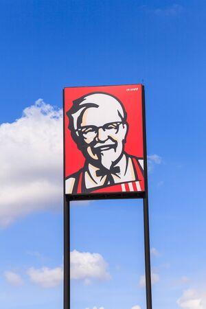 COSTUMERS: BURIRAM, THAILAND- DECEMBER 27, 2016: Exterior view of KFC drive thru in Buriram, THAILAND. KFC is a fast food restaurant chain that specializes in fried chicken