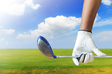 Golf player holding a golf club in golf course