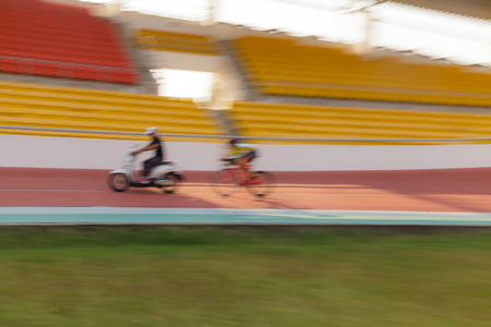 velodrome: Motion blur of Cycle Racing Athlete Competition Sport Racetrack, Training