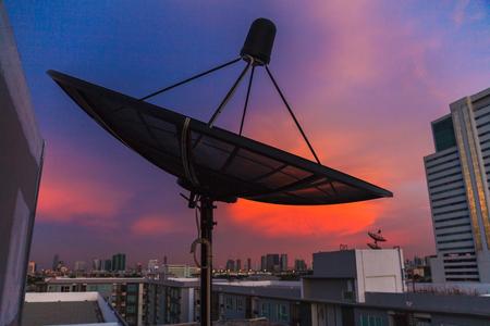 satelite: Satellite dish at twilight sky in the city