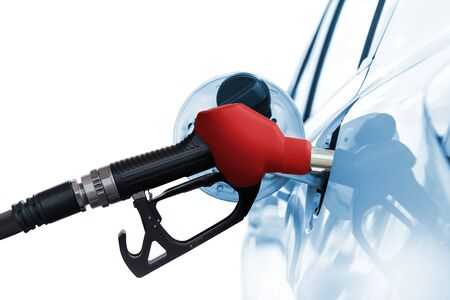Refuel car with petrol, refueling car at the refuel station Stock Photo