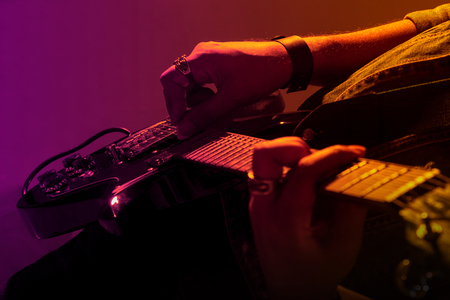 Electric guitar player on a stage, live in concert Stock Photo