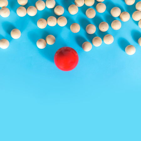 Leadership concept, Red ball and wooden ball with shadow on blue background