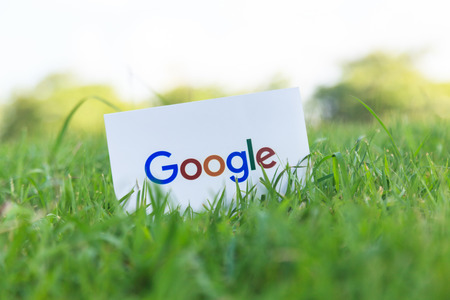 Bangkok, Thailand - June 15, 2017: Google icons printed on paper on green grass in the park. owned by Google.
