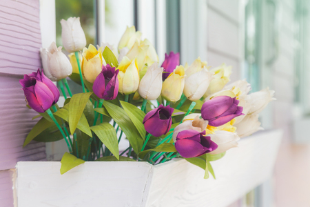 Beautiful artificial flowers in front of the house Stock Photo