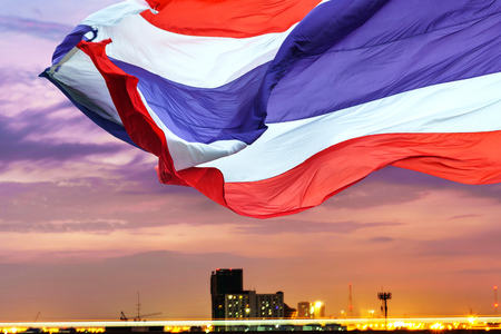 Waving flag of Thailand on twilight sky background