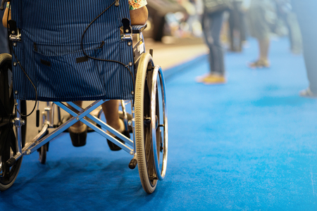 Back view of woman on wheelchair during in in exhibition hall