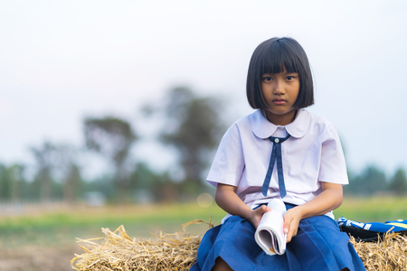 Asian student in uniform studying at countryside of Thailand Stock Photo