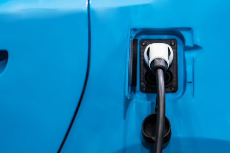 Charging an electric car battery access to vehicle electrification Stock Photo