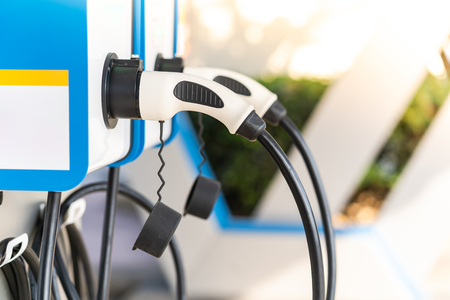 Charging an electric car battery access to vehicle electrification Reklamní fotografie