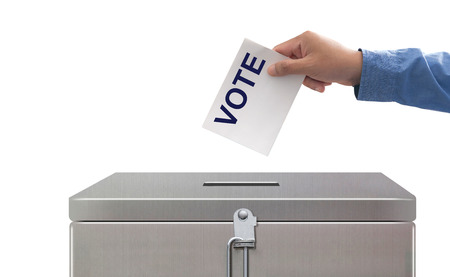 Hand Putting Voting Paper, Elections and democracy concept