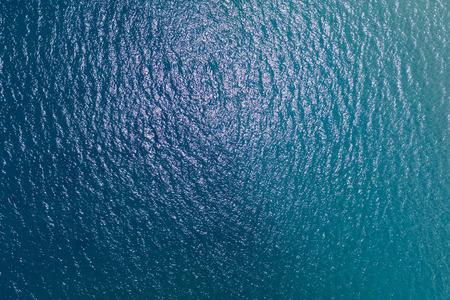 Aerial top view of Blue ocean surface background