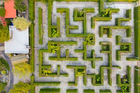 Aerial photo top view medium altitude above of maze green park garden
