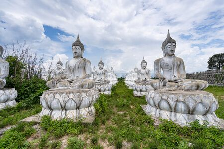 White Buddha statue in Thailand Imagens