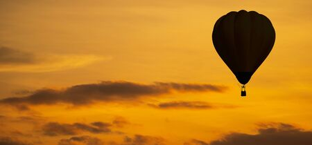 The silhouette of Balloon on sky at sunset