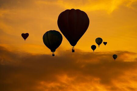 The silhouette of Balloons on sky at sunset