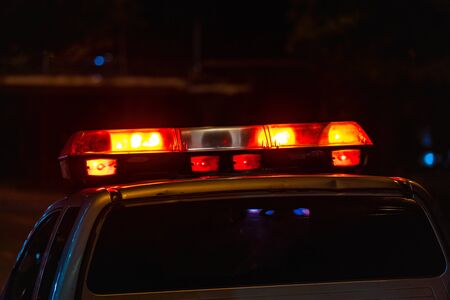 Emergency light, Red light flasher atop of a police car at night