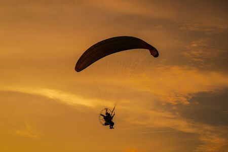 The silhouette of the paramotor at sunset
