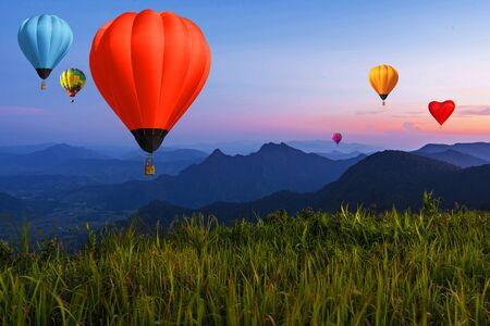 Balloon on twilight sky over high mountains viewpoint at sunset Imagens