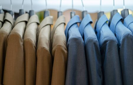 Close up of luxurious style gentlemen suit on hangers