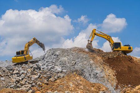 Excavator working outdoors under blue sky