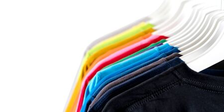 Close Up of t-shirts, Clothes on hangers on white background