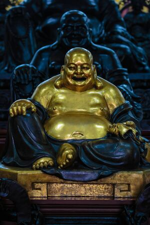 richness: Chinese monk statue represent of wealth and richness