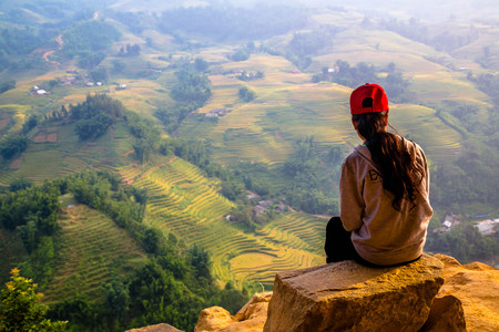 day dream: a lonly girl get lost in day dream with rice terrace scene Stock Photo