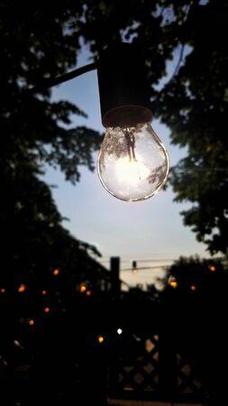 Light bulb . Photo on phone Reklamní fotografie